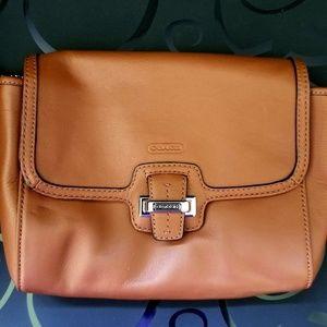 Medium sized leather Coach clutch